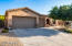 3 car garage with built in overhead and built in cabinet storage.