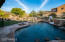 Resort living at its finest! Swim up pool bar, baja shelf for lounging, 2 gas fireplaces, hot tub, heated pool. The works!