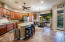 Large kitchen with new stainless steel appliances.