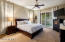 Master suite with private patio door. Imagine warm nights & cool breezes with sounds of the backyard waterfalls. Heaven on earth in your own home!