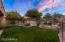 Natural grass backyard, 3 hole putting green, bistro lights and two gas fireplaces.