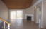 Large Living Room with fireplace. All tile downstairs!