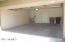 Two-car garage is clean and empty, with epoxy flooring!