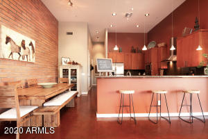 Real brick wall, stained concrete floors throughout