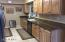 Knotty pine looking, high-end cabinets.