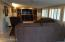 Large AZ Rm, wall of plantation shutters, recessed entertainment area