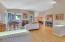 Lighted shelving, high ceilings and classic hardwood accentuate the bright and open Great Room