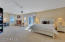 Grand master suite with sitting area, fireplace, breakfast bar and private entry to backyard