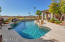 Updated pool, heated spa and boulder water feature with golf course view