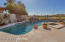 Recently updated pool with boulder water feature, heated spa and view fence to golf course