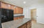 Large kitchen with granite counter-tops, island and huge pantry!