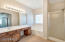 Large master bathroom with separate shower, tub, double-sinks, toilet and large walk-in closet.