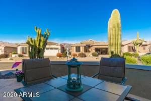 Front patio has custom stamped flagstone coating, enclosed stucco wall all for viewing the Superstition Mountain