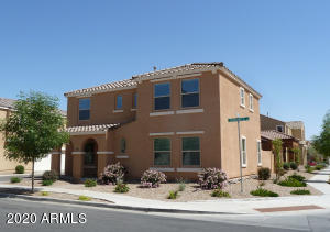 Corner lot in Lyons Gate. Front and side yards maintained by HOA.