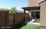 Stepping out of the dining room onto covered patio & private yard.