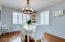 """Dining room is 13'2"""" x 11'3"""" and is bright, sunny and framed by lovely white plantation shutters."""