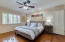 Rich wood floors, white plantation shutters in master