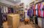 Master closet with custom built-ins.