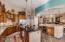 Kitchen view of prep island and kitchen bar