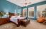 Spacious Master Suite with plantation shutters and private patio entry