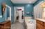 Master Bath offers large shower, separate bath tub, private toilet room and large divided walk-in closet