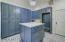 Oversized Laundry Room w/ additional storage & island