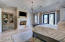 Master Suite w/ fireplace, custom storage & french doors to the backyard