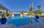 Sparkling pool includes 3 water features, a large baja & swim up bar