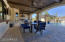 Expansive covered patio w/ ceiling fans & pass-thru from kitchen