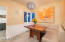 Bright breakfast nook in-between the entry way and kitchen