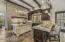 Chef's dream kitchen with Wolf 6 burner/double oven range, side by side Subzero, (2) dishwashers, lots of space to prep, and a large walk-in pantry for storage.