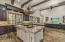 The gourmet kitchen flows easy into the great room and overlooks the professionally designed backyard and patios.