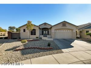 This beautiful Papago model with 4 FT EXTENDED GARAGE is nestled on an oversized private lot in the Guard-gated active adult community of Arizona Traditions.