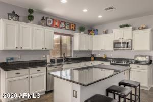 Beautiful kichen with granite counter tops and stainless steel appliances
