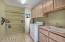Large laundry room with sink and extra storage
