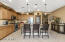 Kitchen with Breakfast Bar and Granite Slab countertops