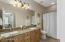 Guest Bathroom with dual vanity sinks and granite slab countertop