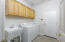 Laundry Room with built-in cabinets and utility sink.