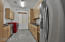 Butler's Pantry/Laundry Room with second stainless steel refrigerator!