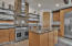 Thermador appliances, open shelving, granite slab island with additional prep sink!