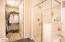 Walk in closet beyond the master bath