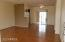 Spacious livingroom with laminate flooring. Rest of house is all tile