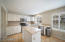 Beautiful white cabinets & kitchen island. Light and bright!