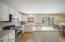 Beautiful white cabinets & kitchen island. Light and bright! Stainless appliances.