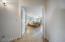 Master Bedroom Ensuite with walk-in closet, wood flooring, double doors & vaulted ceilings.