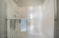 Master bathroom with dual sink vanity, soaking tub and walk-in shower.