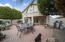 Backyard with extended covered patio and extended patio dining areas.