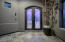 The glass double doors really give a feel of the mood illuminated by cove indoor lighting.