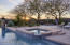 Spa with views of the fire-pit and sunset in the backdrop.