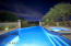 Yes, those are city lights in the distance. Whether day or night the pool has views.